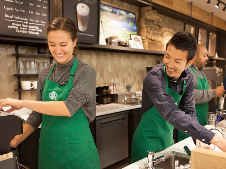 Starbucks baristas making beverages